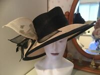 A JACQUES VERT HAT IN BLACK AND CREAM