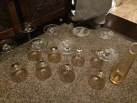 Gold wine glasses ( clear stems) and vase