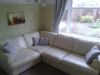 DFS Cream leather corner settee with matching swival chair 'FREYA'
