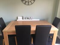 150 cm table and 4 brown chairs