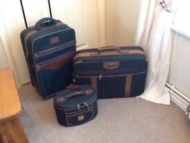3 GREEN SUITCASES
