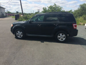 As traded 2010 Ford Escape XLT. No trades. 256,000 KM