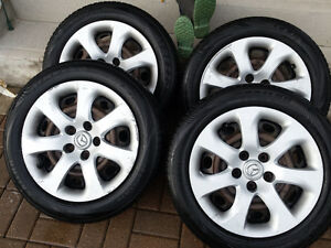 """Mazda 16"""" Steel rims and covers"""