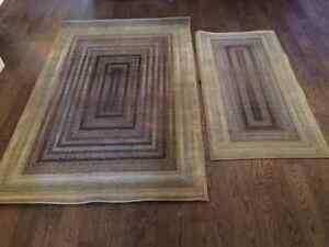Two multicoloured rugs for sale