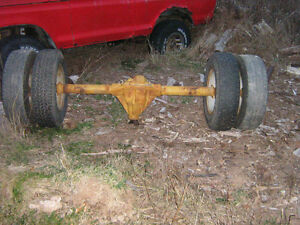 Chev dually rear axle with rims and 16'' tires 350.00