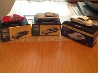 Boxed model cars.