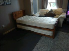 Pine single bed with mattress and trundle bed with mattress