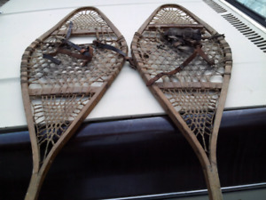 Three sets of wooden snow shoes