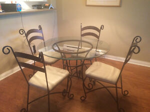 Beautiful glass and genuine leather dining table and chairs