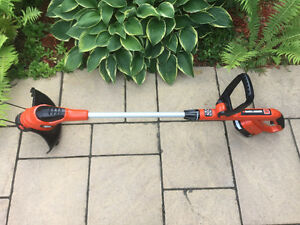 NEW Black and Decker 18 volts Trimmer with Battery & Charger