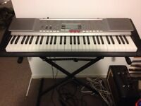 Casio LK-230 Lighted Personal Keyboard  with stand