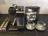 Delonghi Nespresso Machine With Cups, Capsule Caddy And Over 100 Capsules.