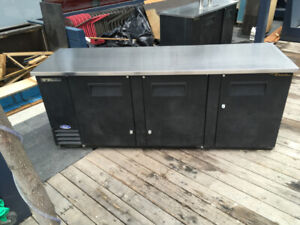 """Used True TBB-4-HC 90"" Three Solid Door Back Bar Refrigerator"""