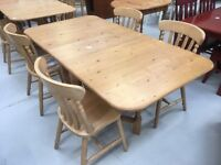 Solid pine drop leaf table and 4 chairs.