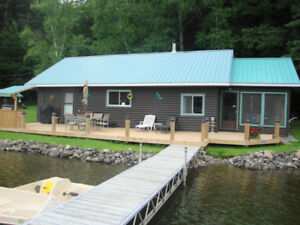 IMMACULATE WATERFRONT COTTAGE ON BRULE LAKE- PLEVNA!
