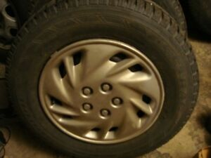 2-195 70 r14 snow tires on 5x100 wheels from dodge car,