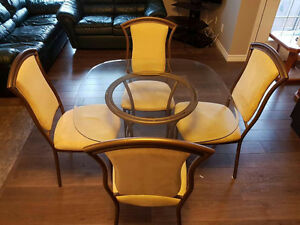 Glass top dining table with 4 chairs - great condition