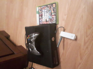 Xbox 360 with game and wireless remote the game is GTA 5