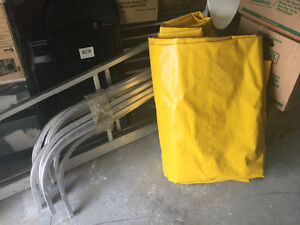 Yellow boat lift cover with all framing and extensions for rack