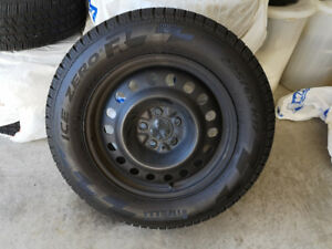 4 Pirelli Ice Zero snow tires like new mounted on Steel wheels