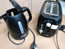 2 slot Toaster and cordless kettle in black. Good working order.. .