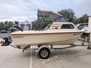 Sportsmancraft fishing boat with Mercury motor & trailer