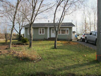 Bungalow with walkout basement and 2 large lots