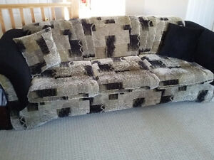 Couch and loveseat set with matching pillows black/brown fabric