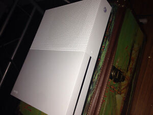 Xbox 1s with a lot of games and 2 controllers