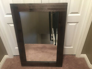 Mirror with brown wood look frame