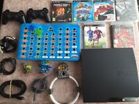 Play station 3 + accessories and 6 games