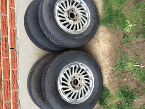 4 MOTOMASTER 215-60-R15 6 MOUTH OLD ON FORD WINSTAR RIMS