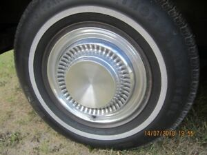 14 inch Chrysler hub cap lost at Wings and Wheels