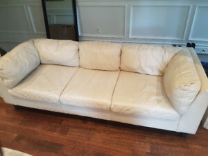 White leather couch and accompanying chaise