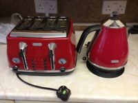 Delonghi kettle and four slice toaster in red