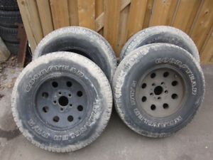 4 Tires 235/75 x 15 On American Racing Rims (GM 5 Bolt pattern)