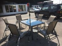 Brand New 6 Seater Glass Top Steel Outside Table with 6 Reclining Steel Chairs And Parasol