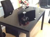Extendable dinning table and chairs