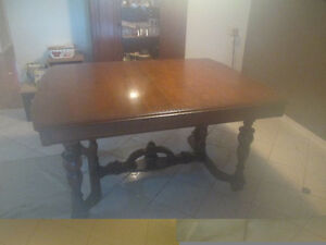 Solid wood dining room table & 5 chairs