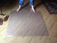 Plastic desk pad for carpet