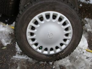 4-175 70r13 directional snow tires on 4x100 wheels. like new