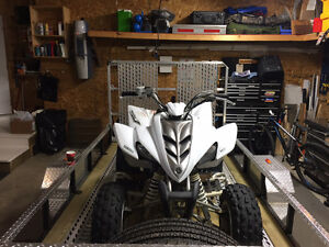 Raptor 350, white. Asking $2499. Great quad, well maintained.