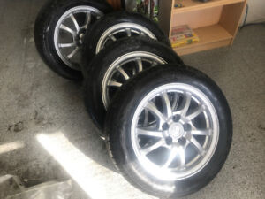 TIRES 205 / 55 ZR 16 WITH ORIGINAL TOYOTA MAGS