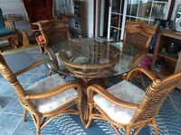Beautiful glass top table with rattan base and 4 chairs