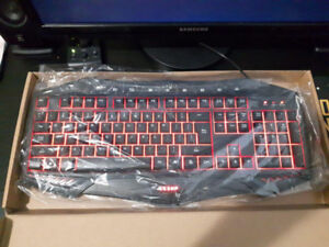Brand New Never Touched gaming keyboard (LESHP Red Backlit)