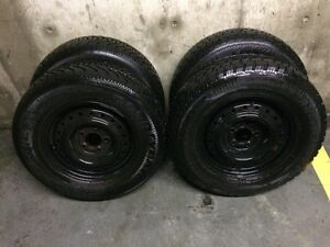 215/70/R15  4 mounted winter tires on black steel rims