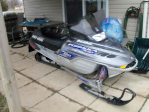 Trade snowmobile and trailer
