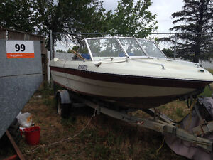 16 Foot Boat With 65 hp Mercury outboard motor And Trailer