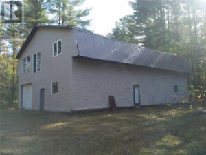Property with a 4800 square foot 2 Story Building/2 Garage Doors