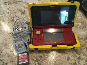 Nintendo 3ds with Nerf cover, charger and 2 games